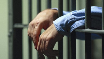 Man Behind Bars --- Image by © Bill Fritsch/Brand X/Corbis